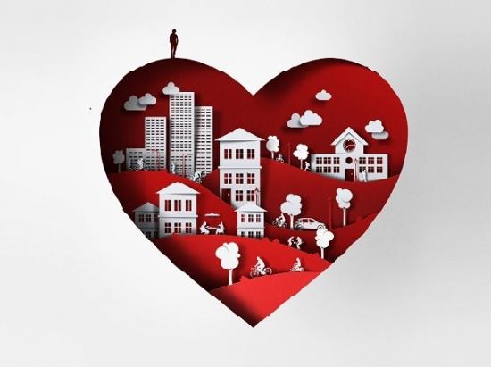 Ett rött hjärta med byggnader målade inuti, i grått. på hjärtat står en stiliserad jätteliten människa.